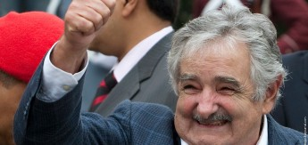 Uruguay's President Mujica waves during a visit to the National Pantheon in Caracas